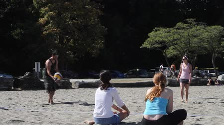 volleyball : VANCOUVER, BC ,CANADA - CIRCA September 2011 :outdoor summer volley - girls watch side view