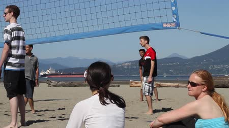 volleyball : VANCOUVER, BC ,CANADA - CIRCA September 2011 :outdoor summer volley - girls watch side mountain view