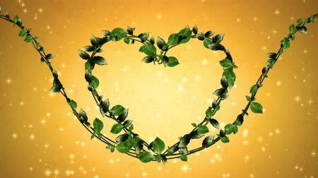 aureate : wreath of leaf, heart shaped, gold background Stock Footage