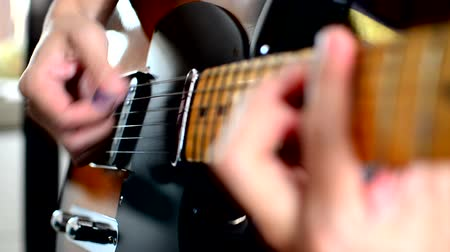 headstock : Play electric guitar Stock Footage