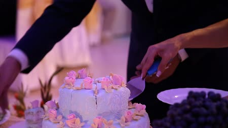 wedding cake : Cutting wedding cake bride and groom