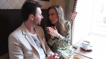 casal heterossexual : Flirting  couple speak in cafe Stock Footage