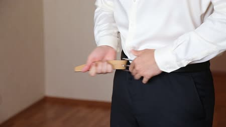 sem camisa : The young man corrects a belt on trousers shoot Stock Footage