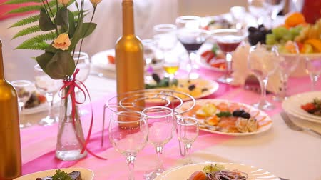 lunch : Served for a banquet table. Wine glasses with napkins, glasses and salads at wedding
