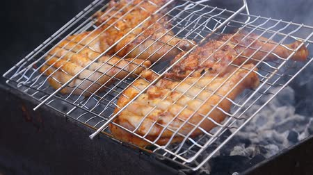 briquettes : Chiken meat on barbeque grill smoke