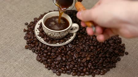 кофе : Pouring Turkish coffee and coffee beans Стоковые видеозаписи