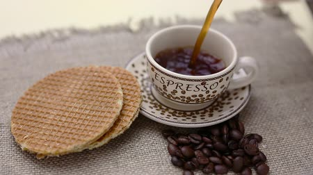 coffee time : dutch stroopwafel, caramel waffle and coffee on table