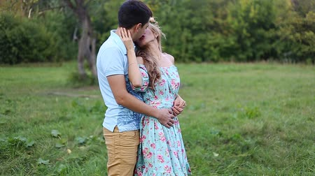 beijos : young couple in love together on nature in summer field