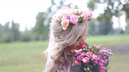 bouquets : beautiful  young girl with a bouquet of flowers