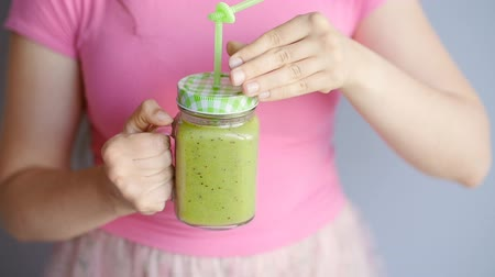 healthyfood : Young beautiful woman enjoying a healthy raw fruit vegetable smoothie Stock Footage