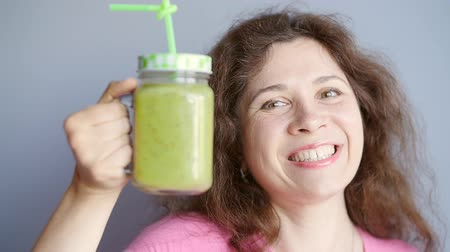 healthyfood : Happy woman enjoying vegetable smoothie