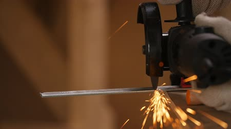 angle grinder : Worker cutting metal with an angle grinder