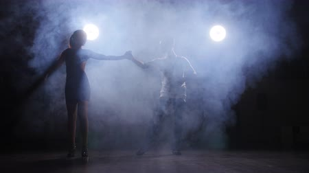 smoke motion : Beautiful couple dancing bachata