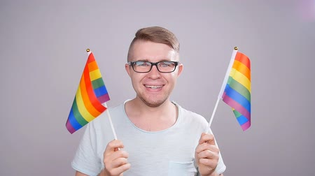 jewish celebration : A man holding a LGBT flag in his hands