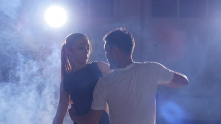 eleven : Beauty couple dancing bachata in dark room
