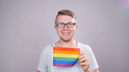 jewish celebration : Man hold a rainbow flag. Concept of sexual minority and LGBT