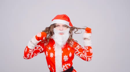 exited : A young woman Santa Claus is dancing
