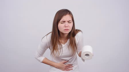 stomach : Young woman having stomachache