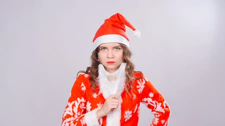 csodálkozó : Funny Christmas girl with red fluffy Santa Hat and beard Stock mozgókép