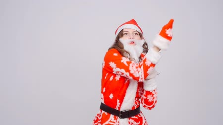 záradék : Funny dancing Christmas girl with red fluffy Santa Hat