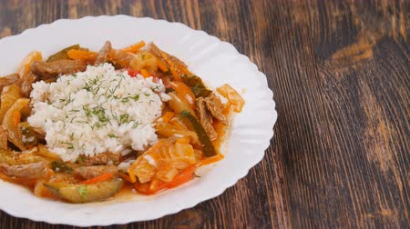 basmati : rice with meat and vegetables on wooden table