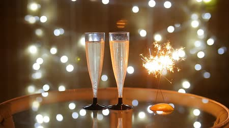 kabarcıklı : New Year Celebration with two champagne glasses and sparkler Stok Video