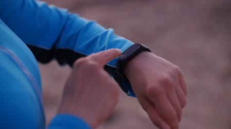 bilezik : Smart watch woman using smartwatch touching button outdoors Stok Video