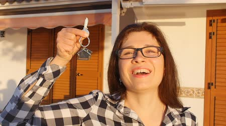 проданный : Happy smiling woman holding house keys of her new house