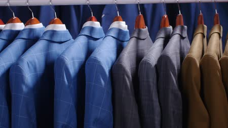 zsebkendő : Men suits and Jackets hanging in a clothing store Stock mozgókép