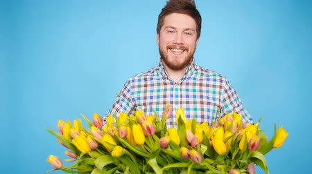 employed : Male florist holding box of flowers