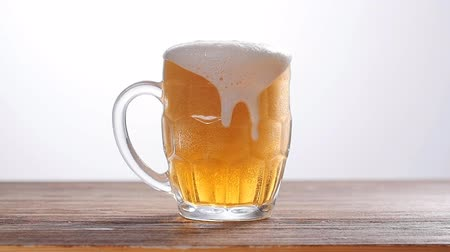 ale : Beer poured into glass on white background