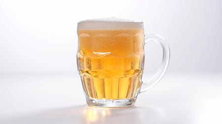 whitebackground : Pouring Glass of light beer