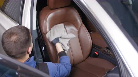 conditioner : Detailing and cleaning of interior front seats at luxury modern cars. Car care concept