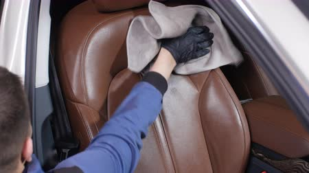 süet : Detailing and cleaning of interior front seats at luxury modern cars. Car care concept