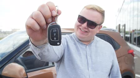 oneperson : Happy man with keys from new car