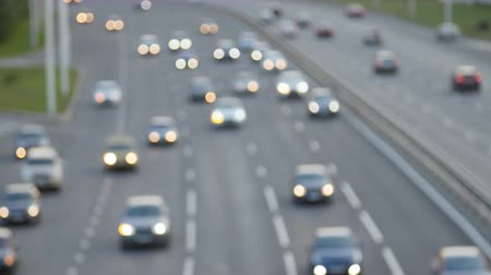 pictured : Cars drive along the highway. Defocus shot Stock Footage