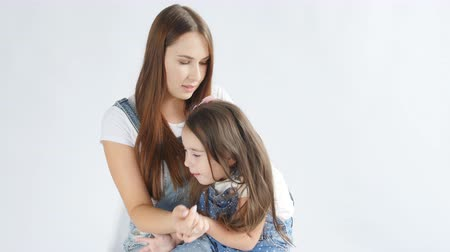blue braid : Family concept. A young mother is combing a little daughter Stock Footage