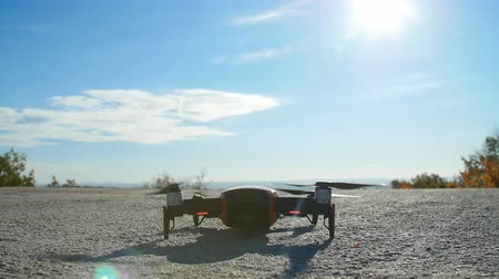 Personal Drone take off from land and flying. Aerial Photography Concept
