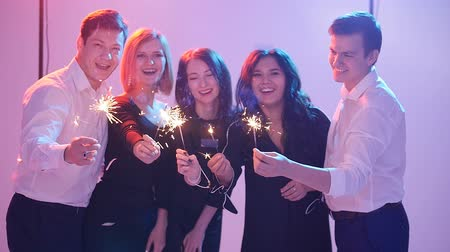 kutluyor : Group of friends having fun with sparklers. Night Party concept