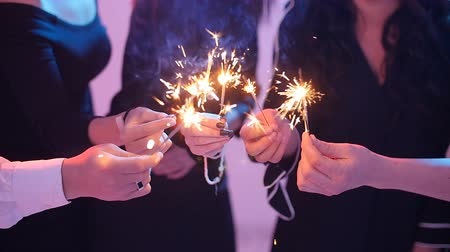 Group of friends having fun with sparklers. Night Party concept