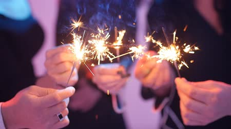 vendég : Group of friends having fun with sparklers. Night Party concept