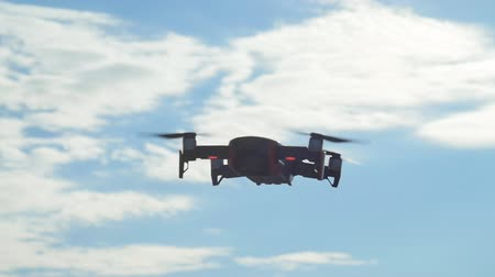 prairie : Concept of personal drones and aerial photography. Quadcopter flying overhead in cloudy blue sky Stock Footage