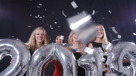 atitude : Happy New Year concept. Group of young women are having fun and holding bigger numbers 2019 Stock Footage