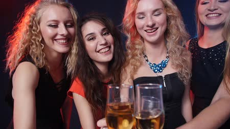 temas animais : Concept of holidays and nightlife. Group of young beautiful women with glasses of champagne at a party