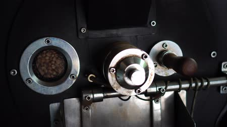 roaster : Dark and aromatic coffee beans in a modern roasting machine : 4k
