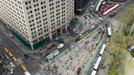 flatiron building : NEW YORK - MAY 7: (Time-lapseZoom-in) Traffic and pedestrians move through Madison Square at the intersection of 5th Avenue and Broadway at 24th Street on May 7, 2014 in New York.