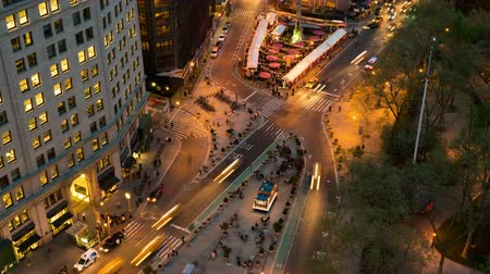 flatiron building : NEW YORK - MAY 7: (Time-lapseZoom-in) Traffic and pedestrians move through Madison Square at the intersection of 5th Avenue and Broadway at 24th Street at twilight on May 7, 2014 in New York.