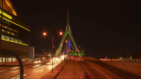 the suspension bridge : (Time-lapse) Traffic crosses the Leonard P. Zakim Bunker Hill Memorial Bridge at night in Boston, Massachusetts.