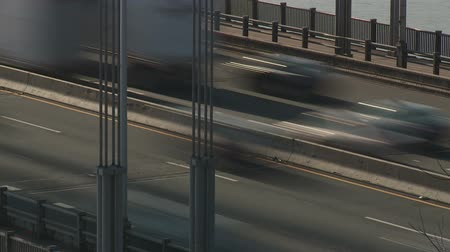 fort lee : (Time-lapse) Morning rush hour traffic on the George Washington Bridge crossing the Hudson River between New Jersey and New York. Stock Footage
