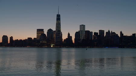 nyc : The Freedom Tower, part of the new World Trade Center complex, rises over the skyline of lower Manhattan during morning twilight in New York City. Stock Footage